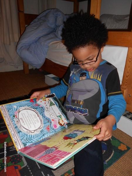 Ezra in glasses reading