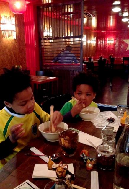 Kids eating at Pho