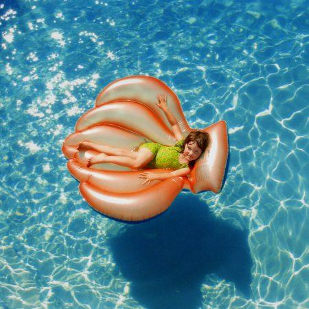 Girl lounging in pool