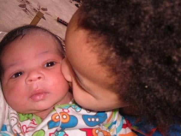 Ezra kissing baby Jed